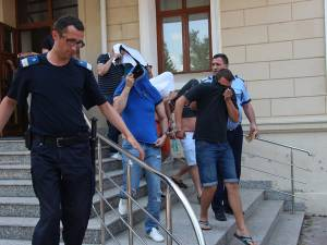 O parte dintre suspecți, duși la arestare în anul 2012